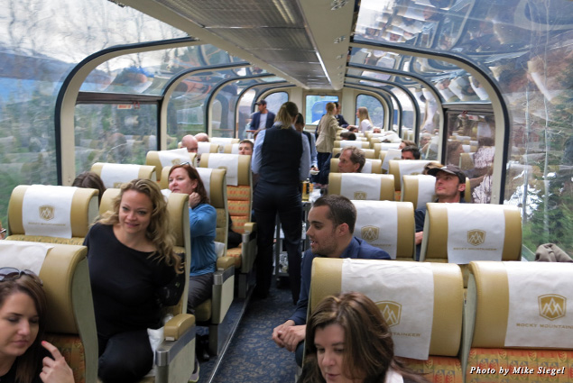 Passengers enjoy the view from the Rocky Mountaineer's two-level, glass-domed coach