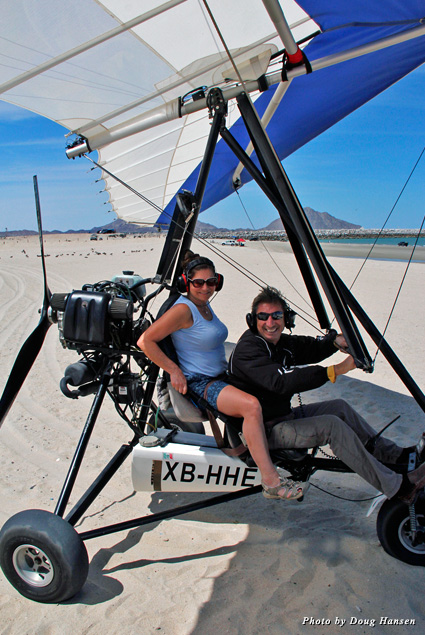 Raphael and my wife getting ready to take off on an ultra-light aircraft