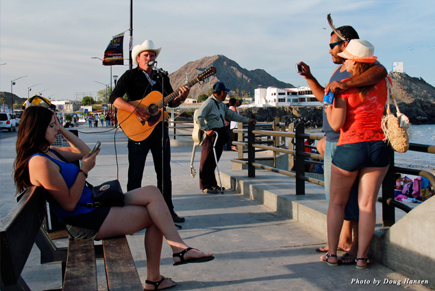 Music fills the air on the Malecon as residents and visitors comfortably mingle