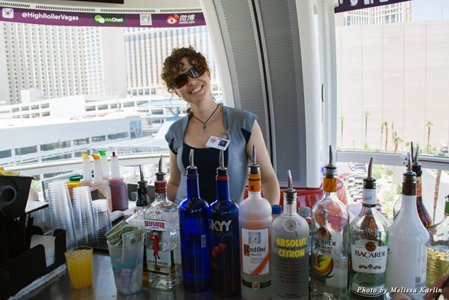 Our bartender smiles behind the bar in the High Roller pod