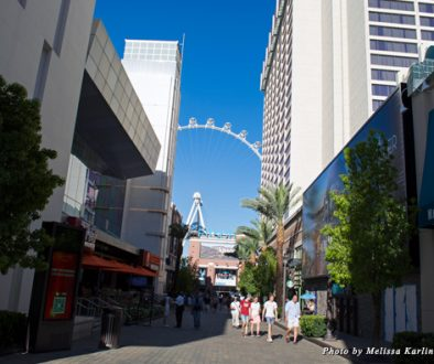 Shopping strip outside the LINQ hotel, with the High Roller observation wheel in the background
