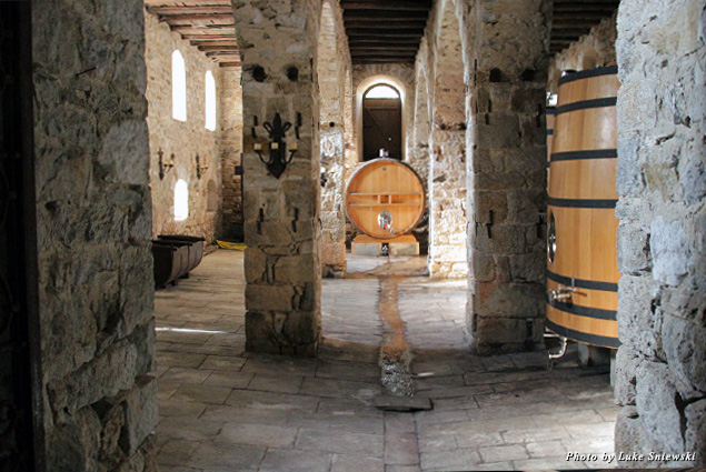 Inside the stone-walled structure at Tsantali Winery, where large wine barrels are held