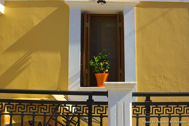 A plant sits in a windowsill in Symi, Greece