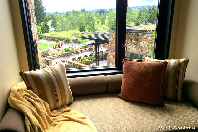 In the guest room, a couch becomes a window seat looking out on the Allison Inn grounds