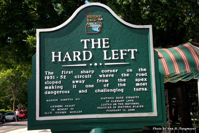 "A sign marks ""The Hard Left"" on the race circuit"