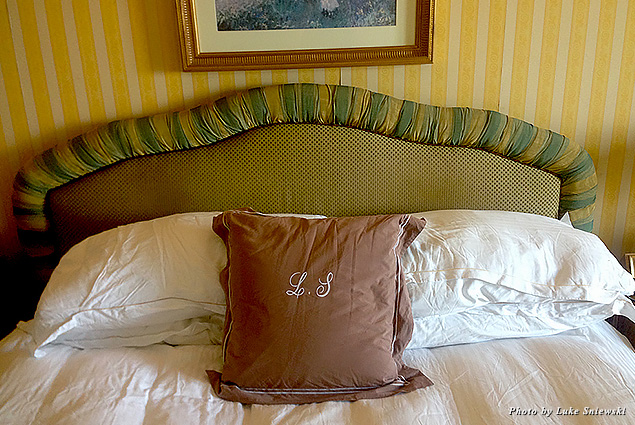 A pillow with my initials stitched onto it on the bed at Le Vendome