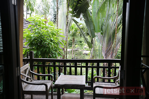 Guest room balcony table and chairs overlooking the Spa Koh Chang grounds