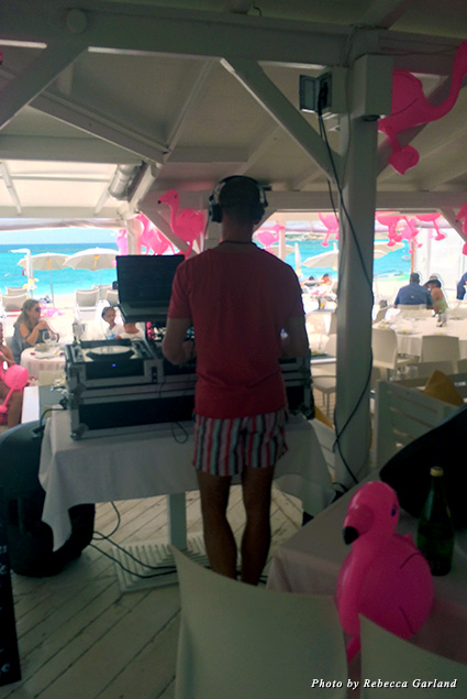 DJ plays music at La Plage's Bikini Brunch