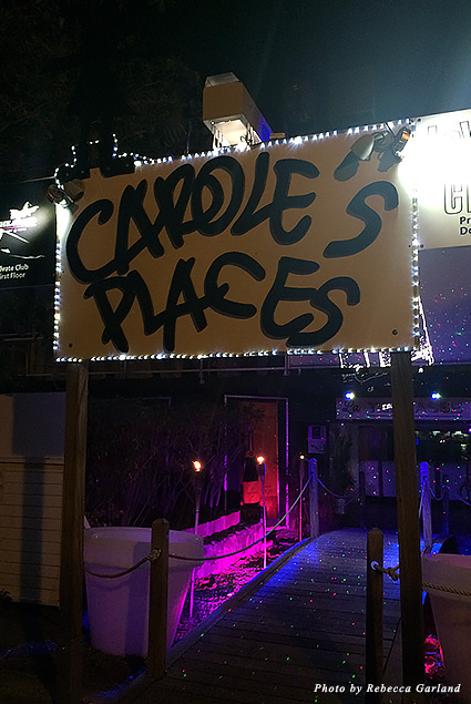 Carole's Places sign outside The First and Le Yacht Club in Gustavia harbor