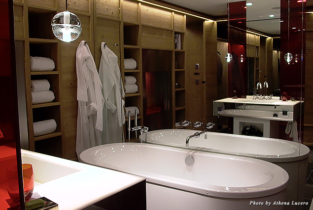 Red-tinted glass partition off the spacious bathroom of the Spectacular Room