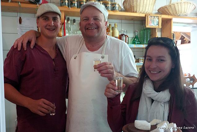 Master cheese-maker Eddy Baillifard (center), local cheese-maker Dominique Rinaldi (left), and Irene Maldonado of Tourism Verbier (right) take a break with fresh raclette and Fendant wine