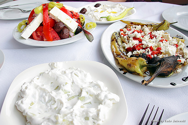 Plates of feta cheese, tzatziki, and peppers at a local restaurant