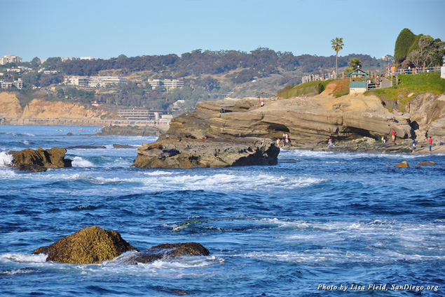 People explore the coves along the shore in La Jolla