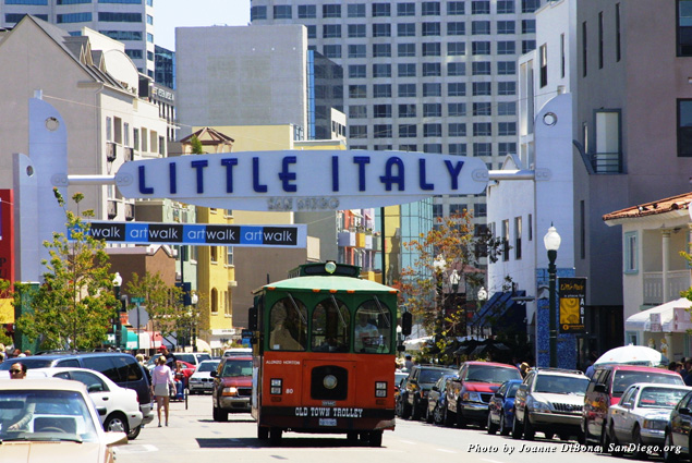 A sign marking the entrance to Little Italy stretches across the street in Downtown San Diego