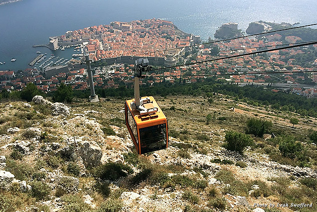 A cable car takes passengers from Mount Srđ back to Old City Dubrovnik