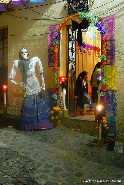 A skeleton image welcomes visitors to a family altar