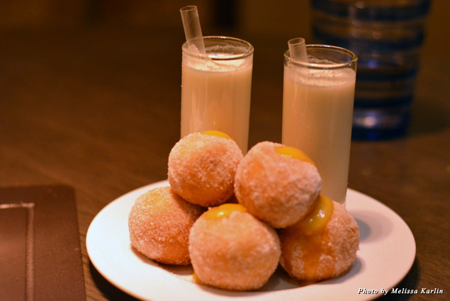 Those doughnuts, freshly made to order, are filled with a variety of jams and sauces and served with a small milkshake, a whimsical addition to the high-class meal