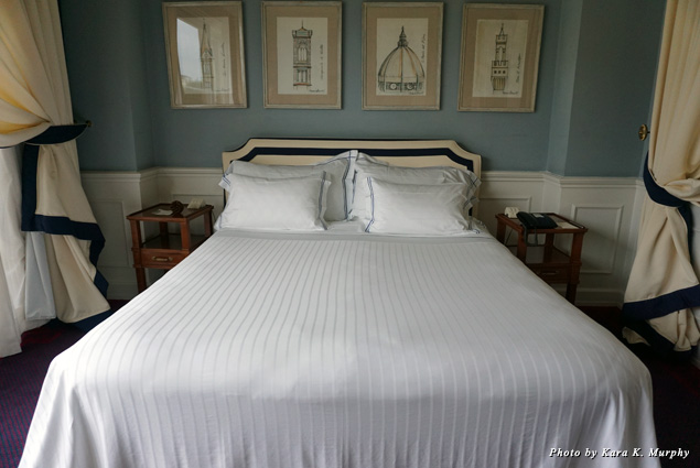 The bed in a guest room at Hotel Lungarno