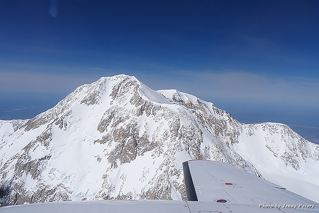 Seeing Denali Mountain's summit from a biplane