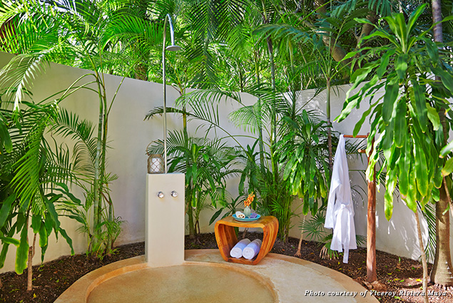 The bathroom opens to a private small garden with outdoor shower
