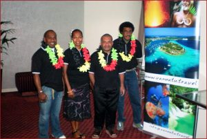Band proudly pose next to Vanuatu islands banner in Wellington's Holiday Inn conference foyer