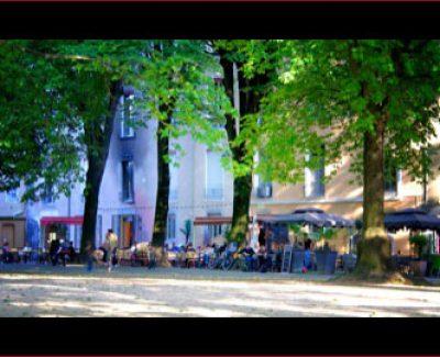 Cafés along the edge of the Jardin de Ville