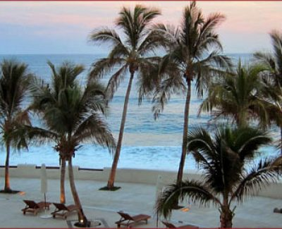 The sky glows pink after the sun sets at Marquis Los Cabos in Cabo San Lucas, Mexico