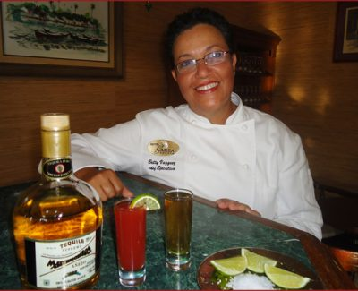 Chef Betty Vázquez shows off her bright and spicy tequila con sangrita