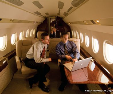 Businessmen use Gogo Inflight Internet