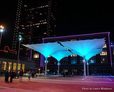 Four 36-foot Teflon umbrellas loom large over the eastern side of the Sundance Square Plaza