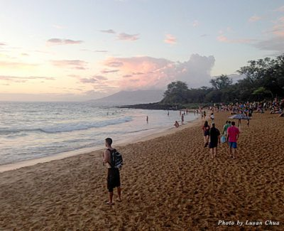 Walking along the beach to the Sunday night drum circle at sunset