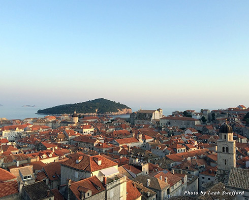Looking out across the red-tiled roofs in Old City Dubrovnik toward Lokrum island